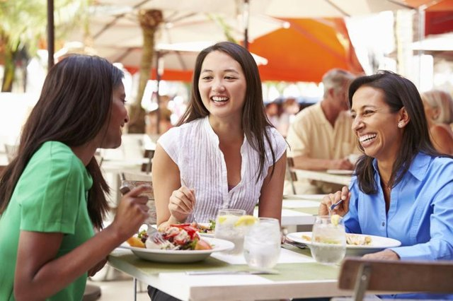 Group of women share a laugh during lunch