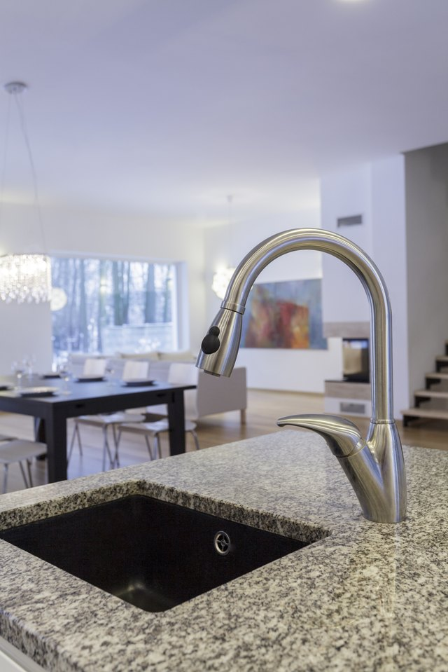 Close-up of a granite countertop with a sink