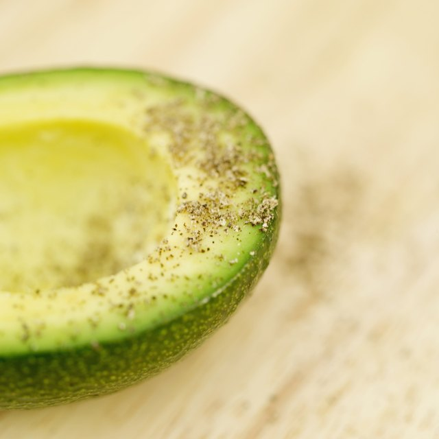 Close-up of peppered avocado slice.