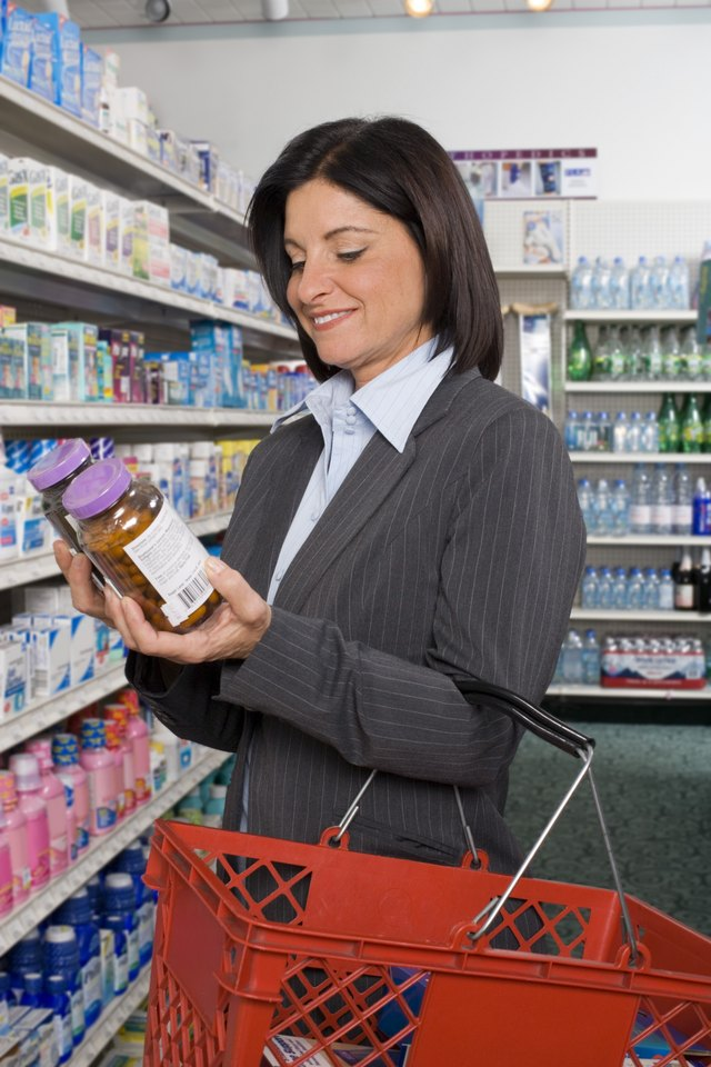 A woman shops for supplements at a health food store.
