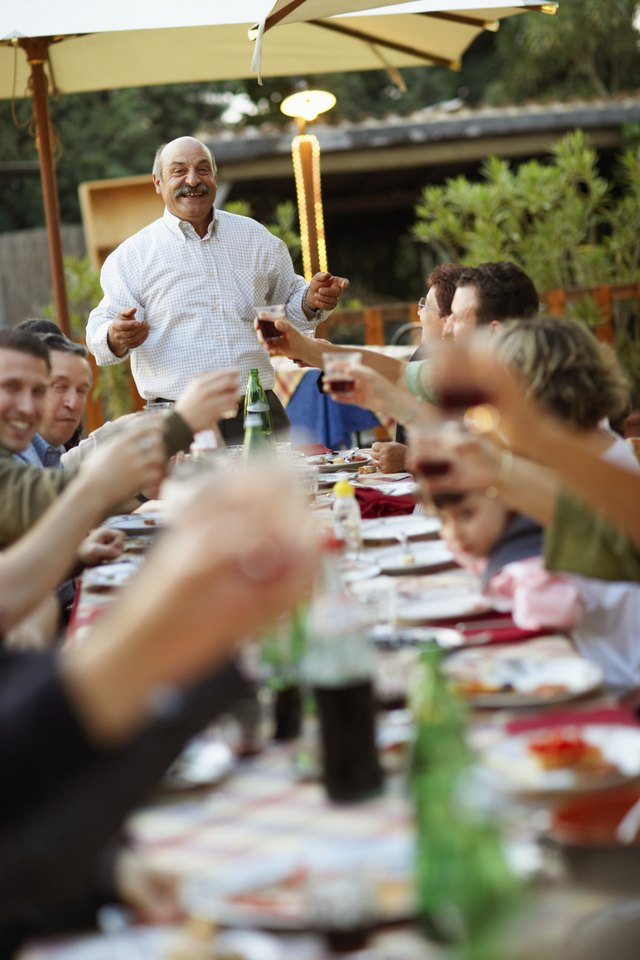 A man makes a toast at a family gathering.