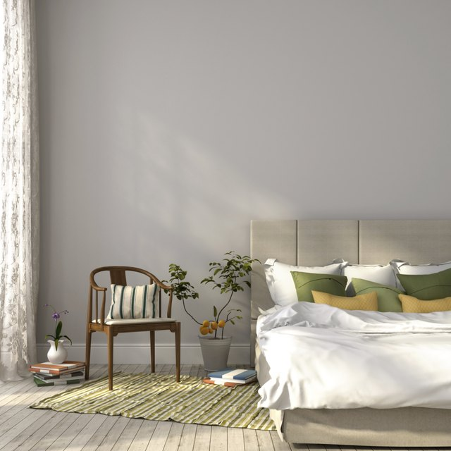 Simple bedroom painted with a grey and beige color scheme