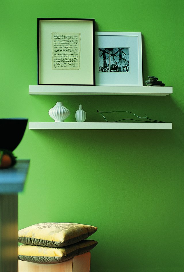 A light green wall will contrast dark sage very well