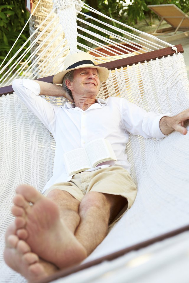 Man wearing long sleeves and shorts in hammock