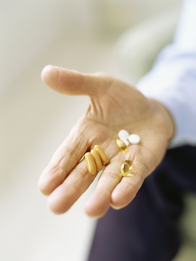 Fish oil capsules can be taken with your standard blood pressure medication to boost your health.