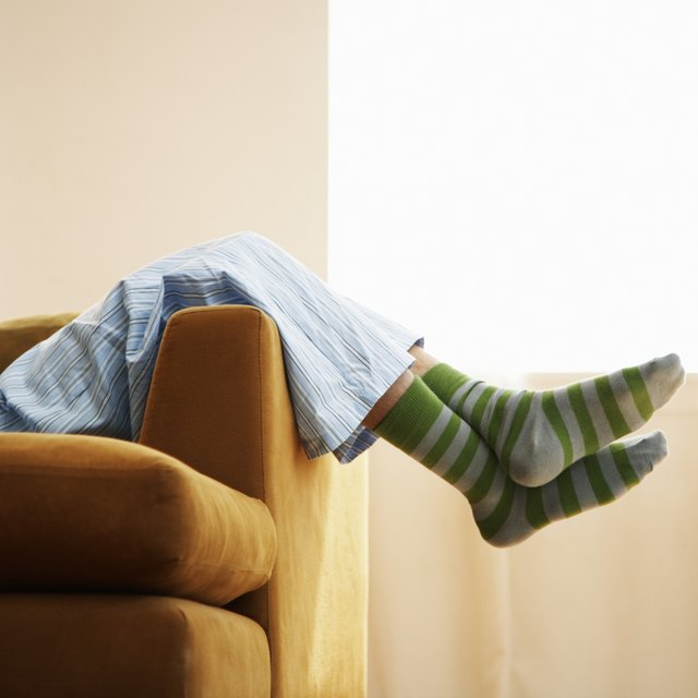 A close-up of a person relaxing on a couch.