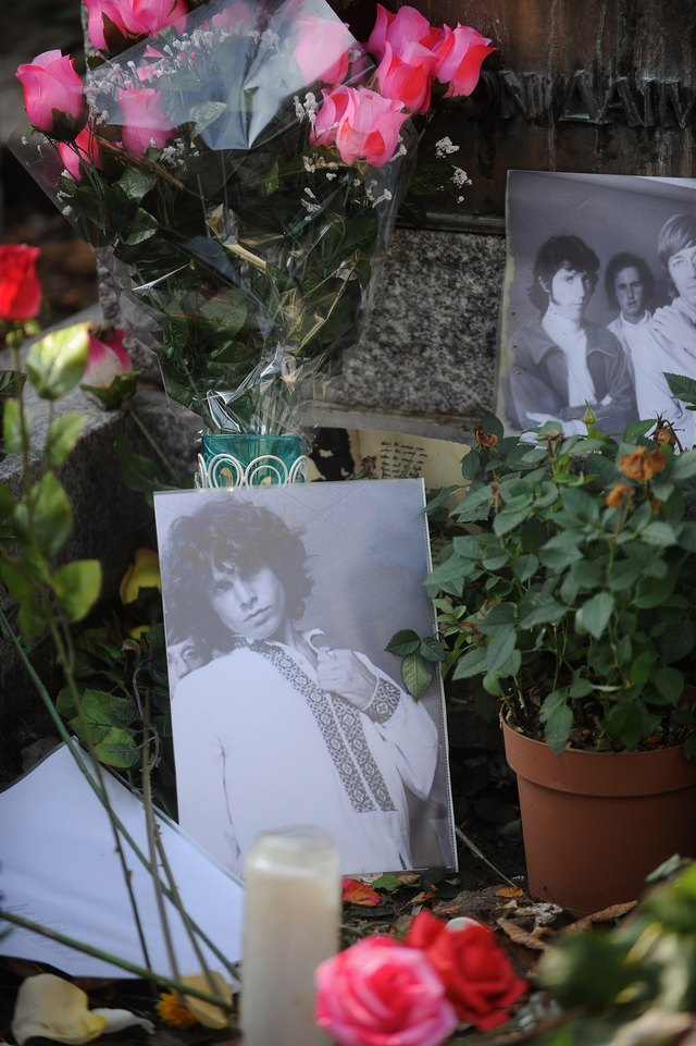 A photograph of The Doors lead singer, Jim Morrison, on an alter.