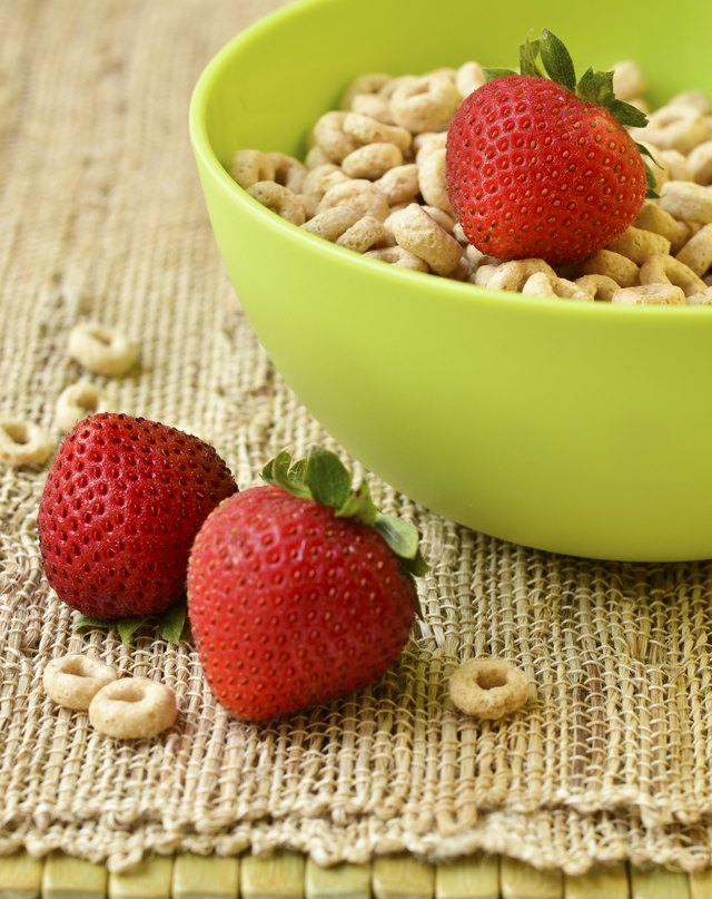 Bowl of cheerios with strawberries