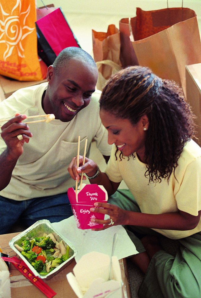 Couple eating Chinese food take out