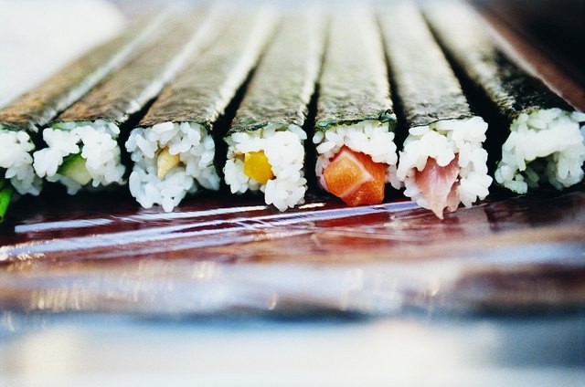 Several rolls of seaweed wrapped sushi.