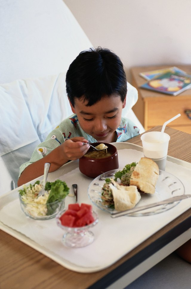 A dietary aide may set up food trays.