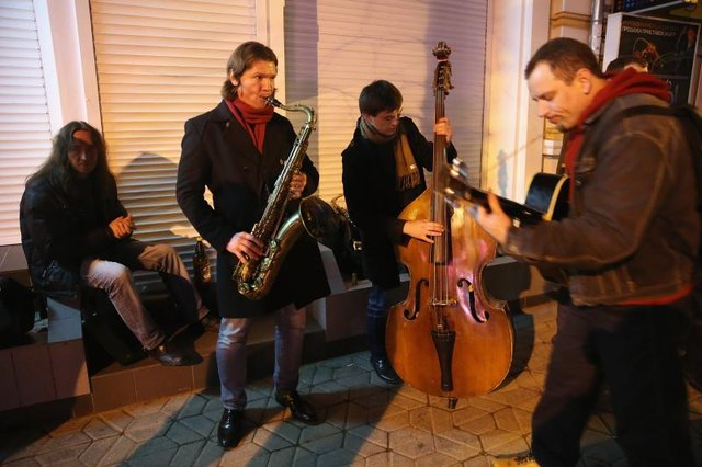 A group of jazz musicians playing in street.