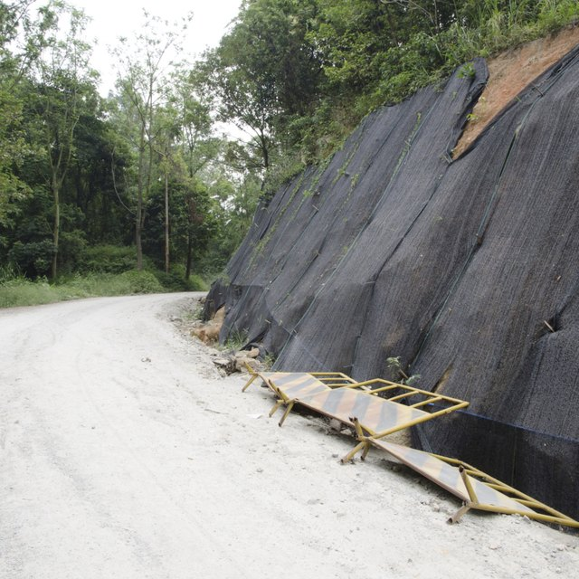 Landslide prevention is set set-up alongside a road in an area affected by an earthquake.