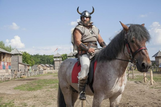 Viking riding a horse.