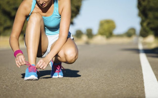 Get laced up and prep for exercise.