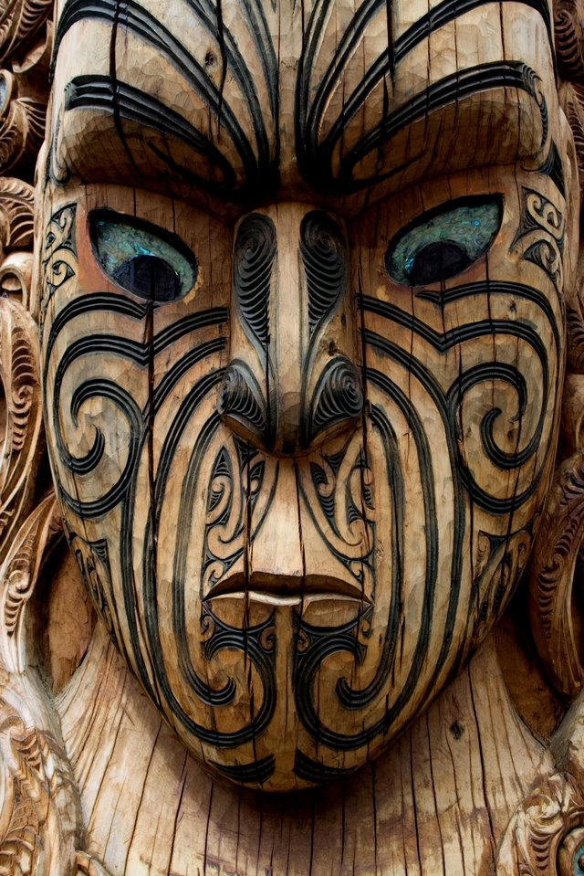 A close-up of a Maori wood carving.
