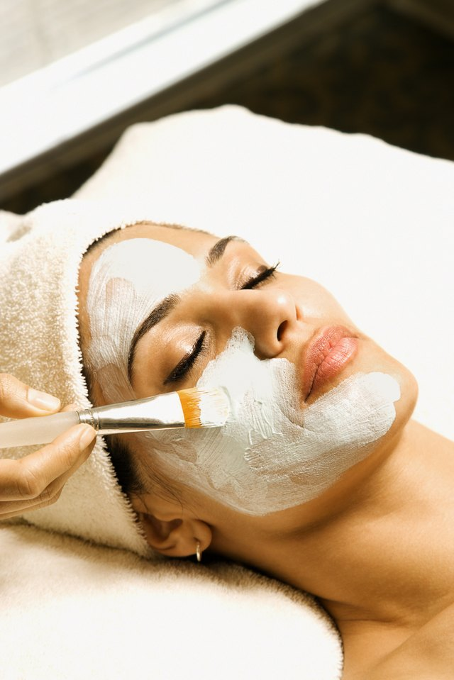 Woman at spa getting a facial