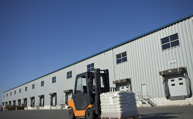 Many forklifts are designed to carry loads on pallets.