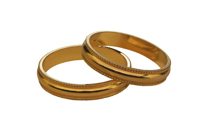Try a nice pair of gold bangles to add some contrast with your silver dress.