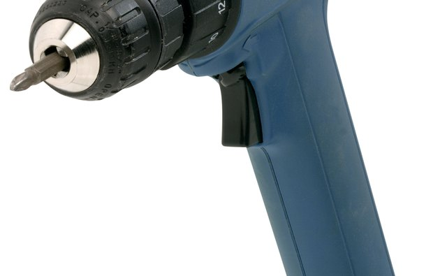 Use a cordless drill because your home's power needs to be off when drilling through the floor.