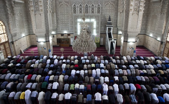Men pray in a Baghdad mosque