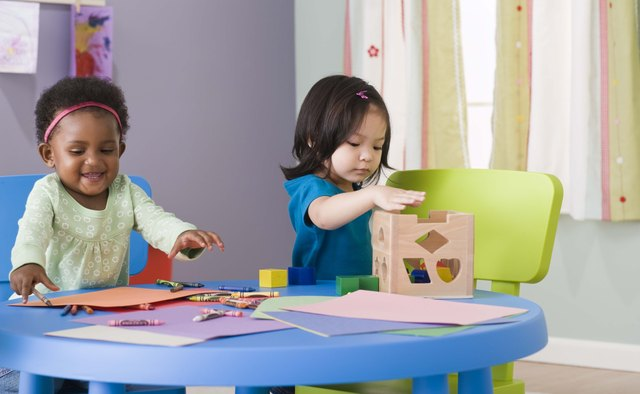 Toddlers engage in parallel play in which they play next to each other before learning to play together.