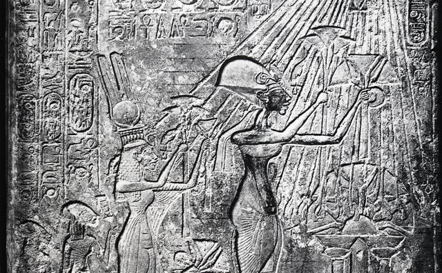Akhenaten and his family make offerings to the sun god Aten.