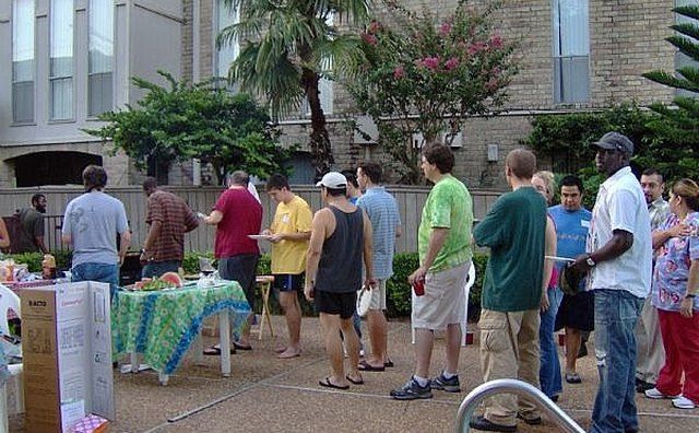 Lots of people line up for good food at a National Night Out Party.