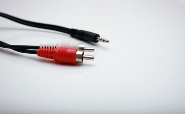 Example of 1/8 inch audio cable (in background) and stereo audio cables (red and white).