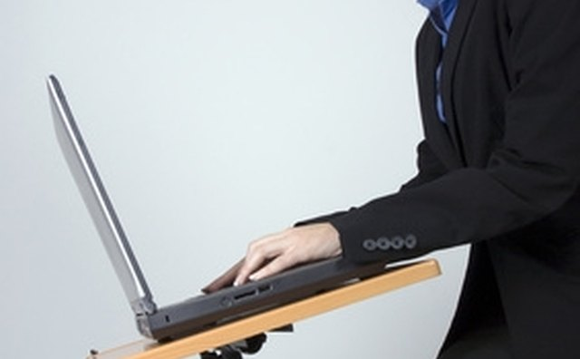 Sit upright with floated wrists when typing.