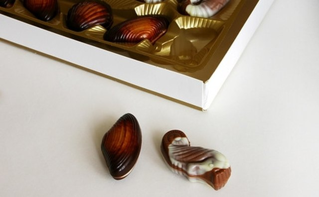A box of chocolates is a delicious gift for food-loving parents.