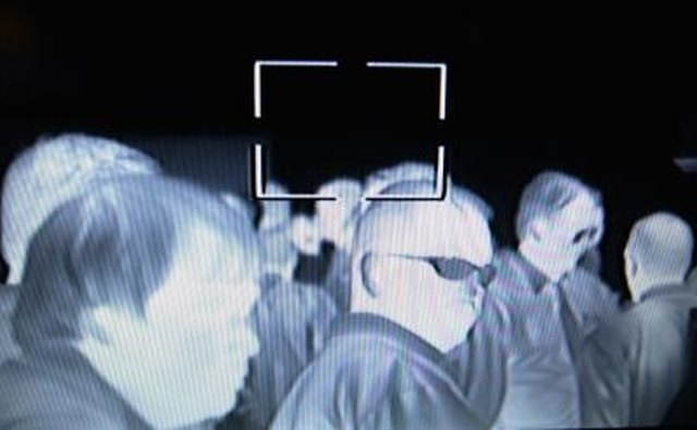 In this IR image, it's easy to see that the visibly transparent eyeglasses are opaque to infrared.