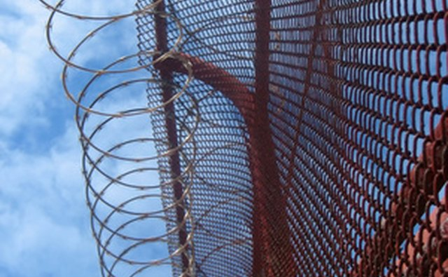 Prisons have barbed wire fences around their perimeters.
