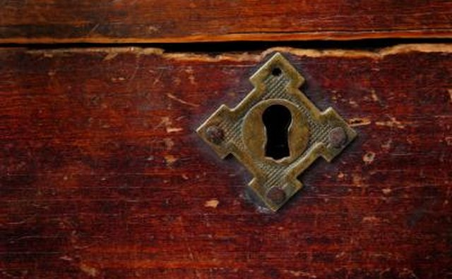 A close-up of a box with a key hole.