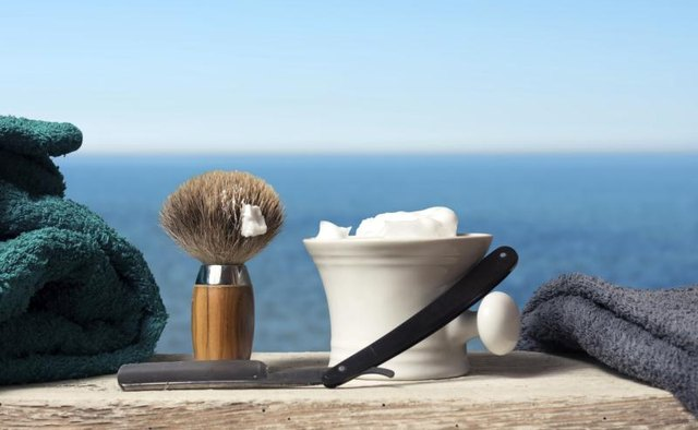 Old fashion shaving kit with brush, razor and cream.