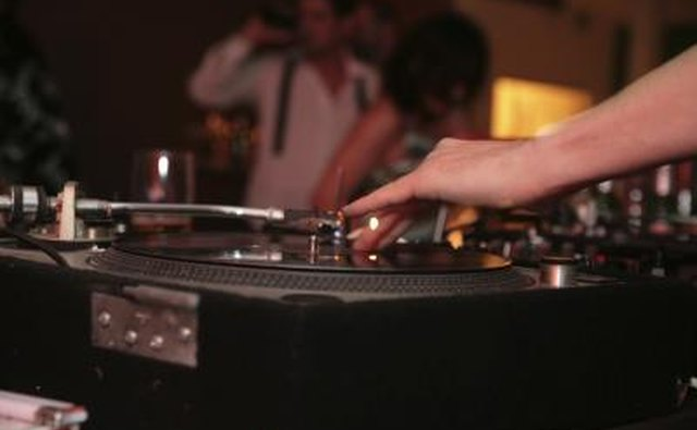 A DJ spinning records at a house party.
