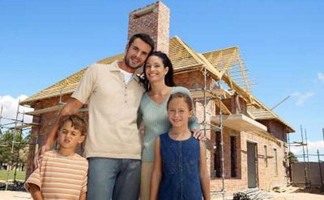 family infront of home being built