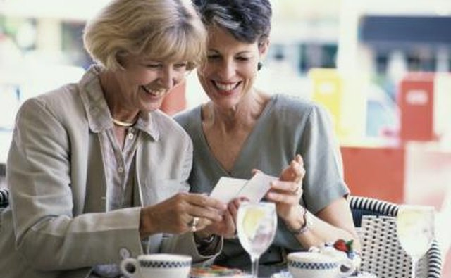 Two mature women looking at a photograph