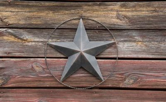 A close-up of an antique barn star on an old barn.