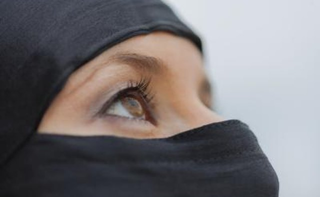 Close up of a veiled young woman