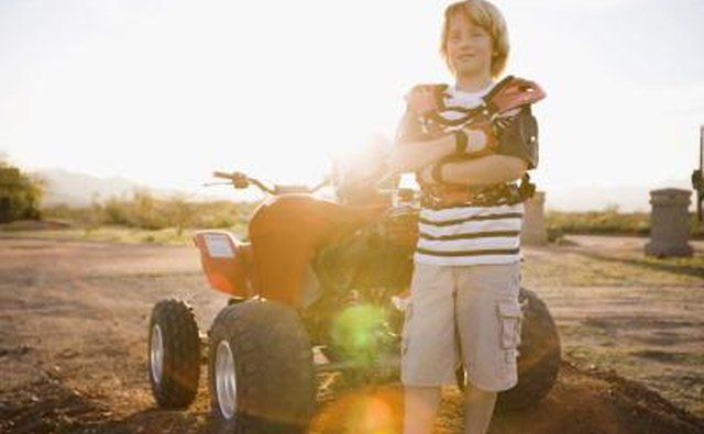 Boy next to ATV