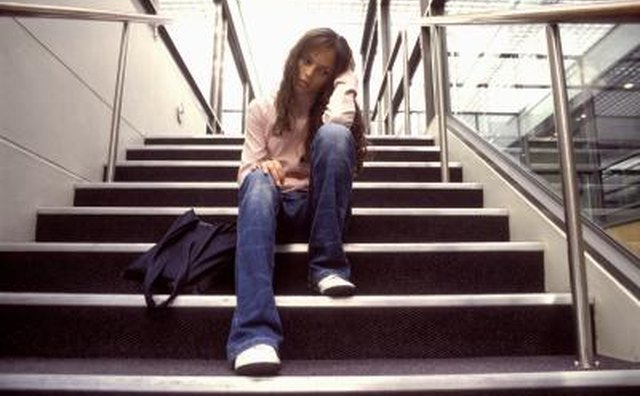 Girl sitting on stairs of high school
