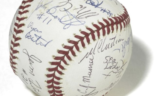 If you have a company softball team, ask everyone to sign a special ball.