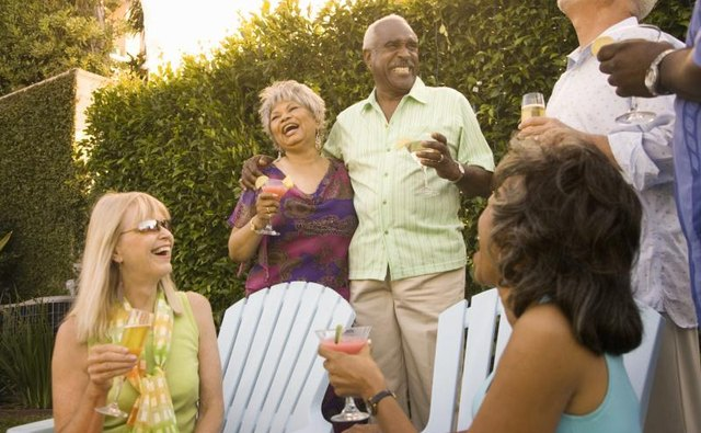 People laughing at a backyard gathering.