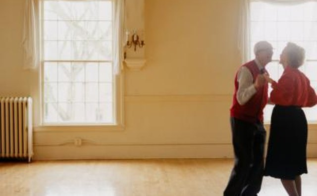Senior couple dancing in empty room