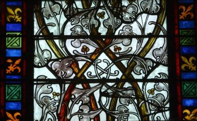 Fleur-de-lis on a stained glass window in France.