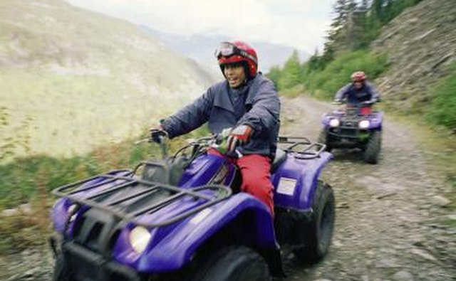 Friends riding ATVs