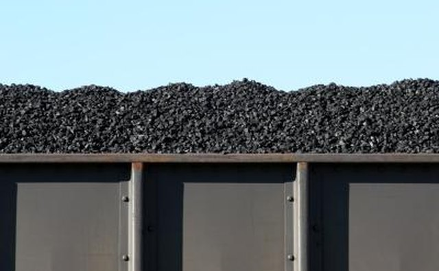 A boxcar filled with coal.