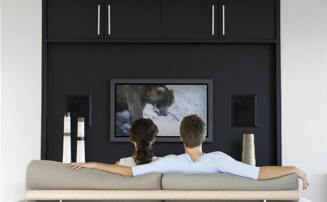 A couple watching TV in their living room