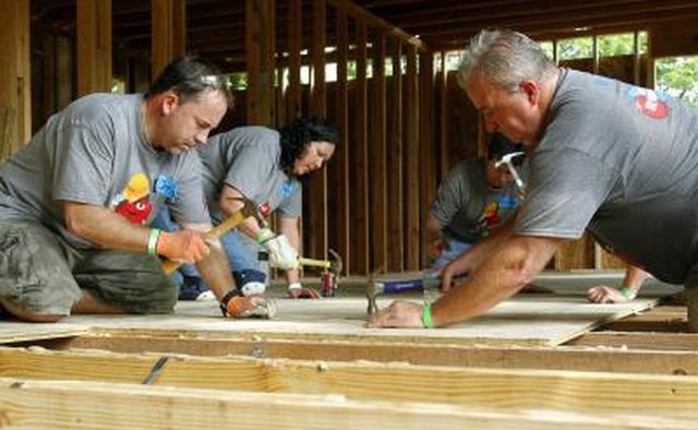 Habitat for Humanity volunteers building a house